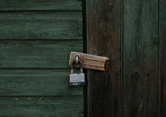 Image of padlocked door